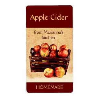 Manzanas rojas frescas en una sidra de manzana de  etiquetas de envío