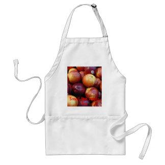 Manzanas rojas jugosas delantal