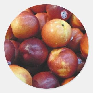 Manzanas rojas jugosas pegatina redonda