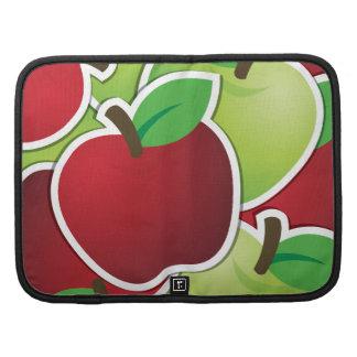 Manzanas rojas y verdes planificadores