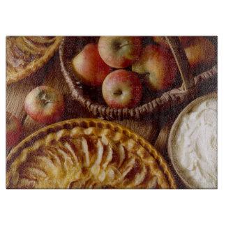 Manzanas, tajadera de cristal agria y poner crema tabla para cortar