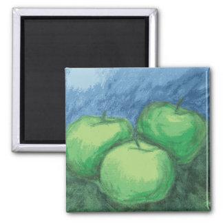 Manzanas verdes en pasteles del aceite imán de frigorifico