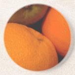 Manzanas y naranjas posavaso para bebida