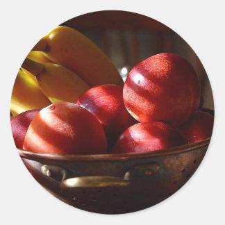 Manzanas y plátanos etiquetas redondas