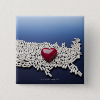 Map of USA made of pills with red heart Button