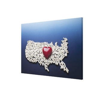 Map of USA made of pills with red heart Canvas Print