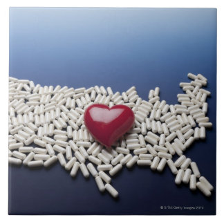 Map of USA made of pills with red heart Ceramic Tile