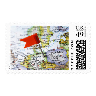Map pin placed in Berlin, Germany on map, Postage