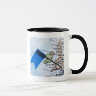 Map pin placed in London, UK on map, close-up Mug