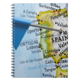 Map pin placed in Madrid, Spain on map, close-up Notebook