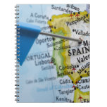 Map pin placed in Madrid, Spain on map, close-up Spiral Notebook