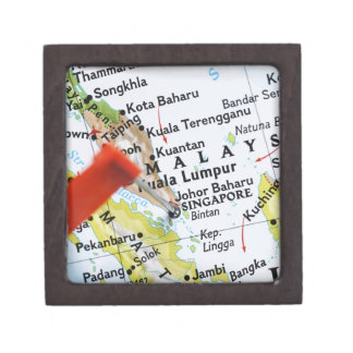Map pin placed in Singapore on map, close-up Gift Box