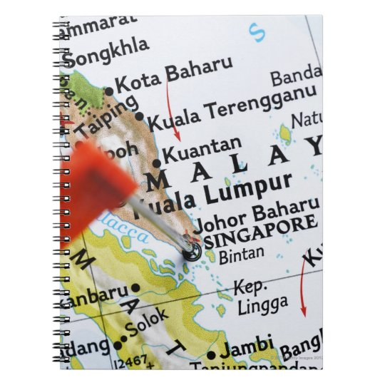 Map pin placed in Singapore on map, close-up Notebook
