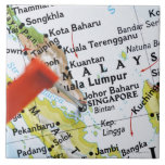 Map pin placed in Singapore on map, close-up Tile