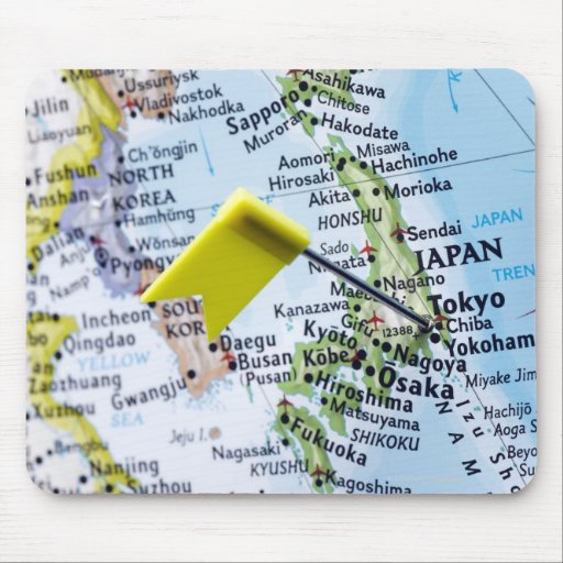 Map pin placed in Tokyo, Japan on map, close-up Mousepads