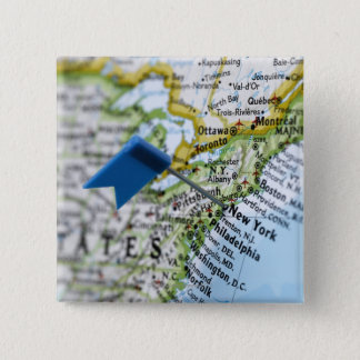 Map pin placed on New York City on map, close-up