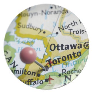 Map pin placed on Toronto Canada on map Dinner Plates