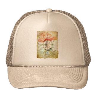 Mapa, compás, gorra de los rosas