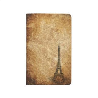 Mapa de París y diario viejos del bolsillo de la t Cuadernos