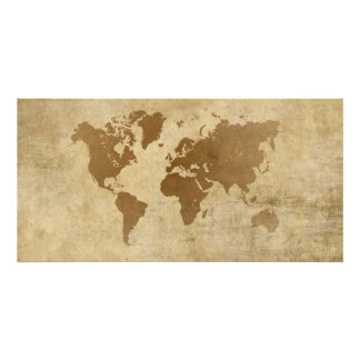 Mapa del mundo descolorado del pergamino fotografía