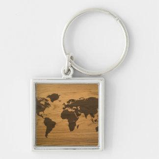 Mapa del mundo texturizado viruta llavero cuadrado plateado