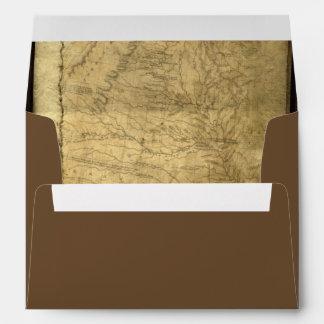 Mapa del pirata del vintage, monedas de oro y apar sobres