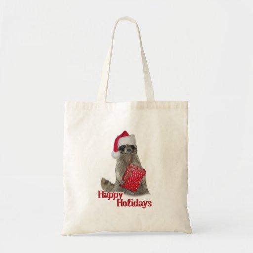 Mapache del bandido del navidad con el presente bolsa