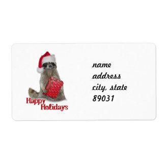 Mapache del bandido del navidad con el presente etiqueta de envío