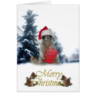 Mapache del bandido del navidad con el presente tarjeta de felicitación
