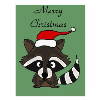 Mapache divertido en arte del navidad del gorra de postal