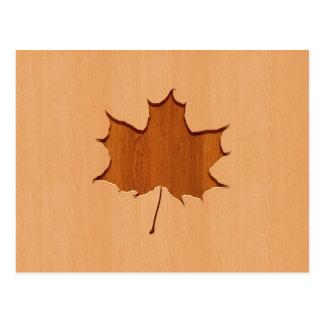 Maple leaf engraved on wood design postcard