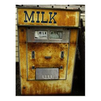 Máquina antigua de la leche postales