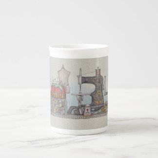 Máquina de coser manual taza de porcelana