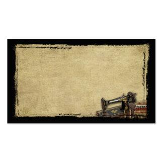 Máquina de coser vieja y tarjetas de visitas tarjetas de visita
