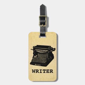 Máquina de escribir antigua del escritor etiquetas maleta