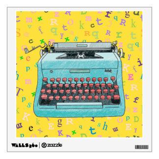 Máquina de escribir azul en etiqueta amarilla vinilo