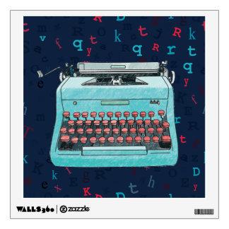 Máquina de escribir azul en etiqueta azul vinilo adhesivo