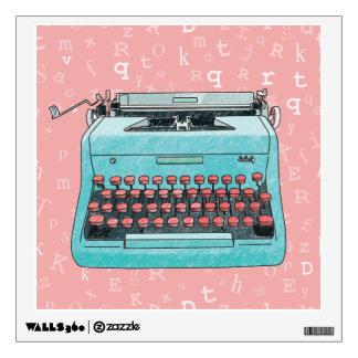 Máquina de escribir azul en etiqueta rosada vinilo adhesivo