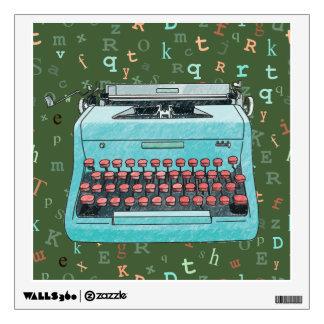 Máquina de escribir azul en etiqueta verde vinilo