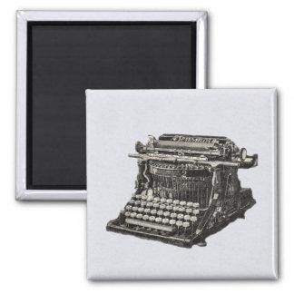 Máquina de escribir pasada de moda negra antigua d imán cuadrado