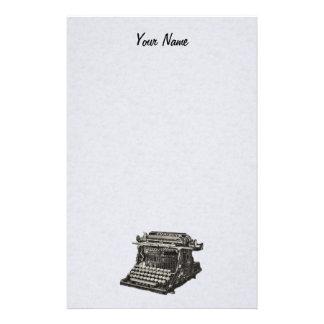 Máquina de escribir pasada de moda negra antigua d  papeleria de diseño
