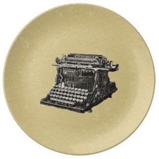 Máquina de escribir pasada de moda negra antigua platos de cerámica