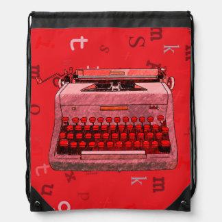 Máquina de escribir retra a mano roja mochilas