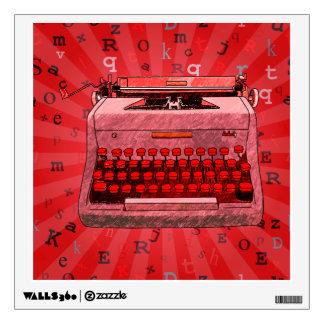 Máquina de escribir roja en etiqueta roja vinilo adhesivo