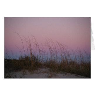 Mar de la puesta del sol en la isla de Sullivan, S Tarjeton