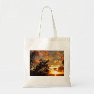 Mar de la puesta del sol y bolso de oro de bolsa tela barata