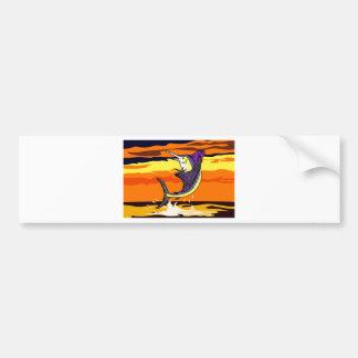 mar de salto del pez volador con puesta del sol pegatina de parachoque
