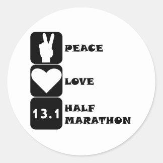 Maratón del amor de la paz medio pegatina redonda