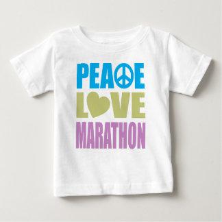 Maratón del amor de la paz playera de bebé