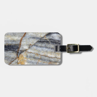 Marble surface with fractures. bag tag